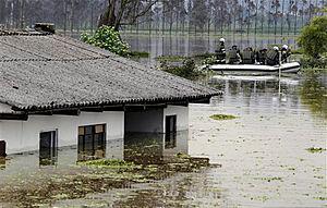 Colombia police patrol hard hit flood areas