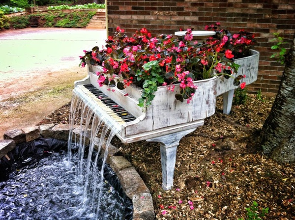 old instruments like pianos guitars and drums can be turned into a garden planter and if you got the skills you could make something like