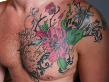 man with flower tattoo