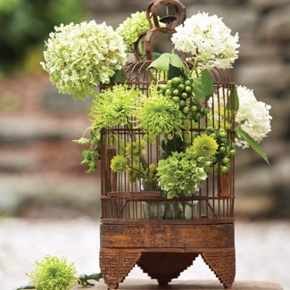 birdhouse floral arragement with hydrangea and hypericum berries