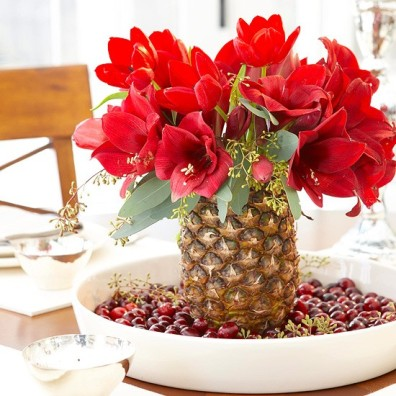 christmas centerpiece with amaryllis in a pineapple vase