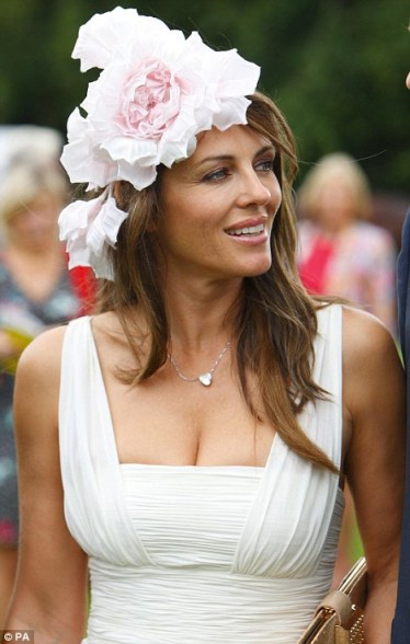 actress elizabeth hurley in floral fascinator