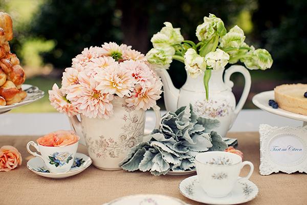 flowers in antique tea pots