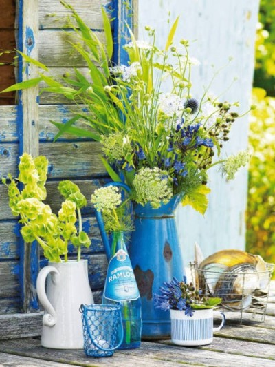 Vintage containers as vases