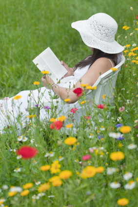 woman in the garden reading