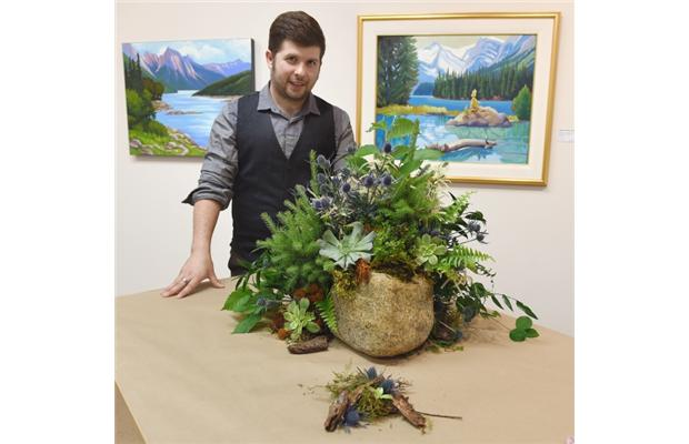 Cory Christopher tied his floral design for the Art in Bloom Festival to a series of Rocky Mountains paintings by Vancouver artist Tatjana Mirkov-Popovicki at the Lando Gallery.