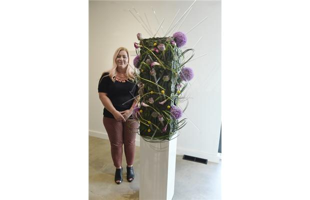 Janine Sebastian at the Peter Robertson Gallery with her floral arrangement for the Art in Bloom Festival.