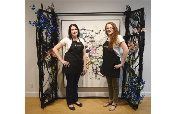 Sam Kluthe and Margaret Hinkley, owners of Two Buds Floral Artistry, with their floral installation for the Art in Bloom Festival, being shown at the Bugera Matheson Gallery.